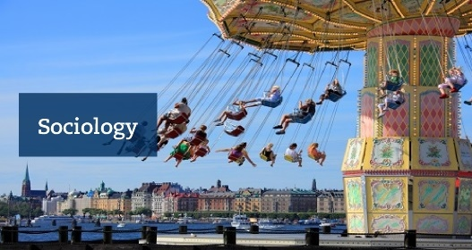 "People at a carousel in Stockholm with the text ""Sociology"". Photo: Mostphotos"
